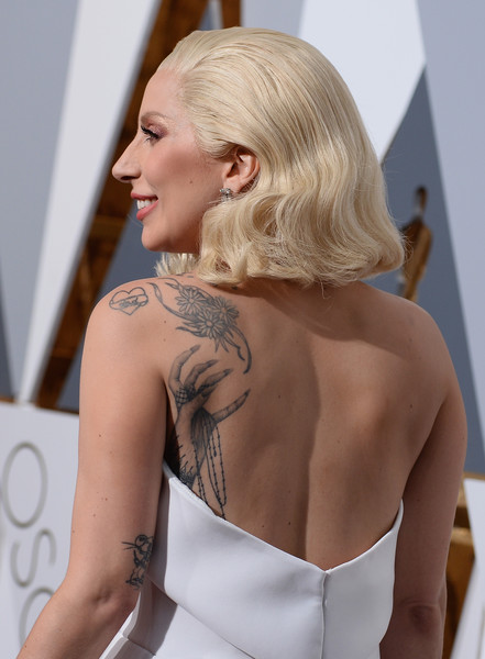 Lady Gaga Flower Tattoo [hair,shoulder,blond,hairstyle,beauty,dress,tattoo,arm,joint,fashion,arrivals,lady gaga,academy awards,hollywood highland center,california,88th annual academy awards]