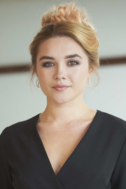 Florence Pugh completed her look with a pair of modern gold hoops.