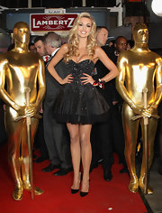 Rosanna Davison balanced her full mini dress with sleek pointy black pumps.