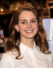 Lana Del Rey wore her golden brown tresses in soft spiral curls and waves at an Ameoba music store in Hollywood.