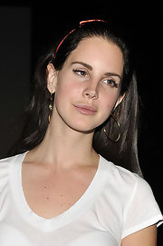 Lana Del Rey's gold hoop earrings spiced up her simple style.