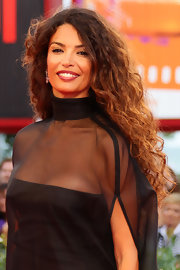 Afef Jnifen showed off her lovely long curls on the red carpet at the Venice Film Festival.