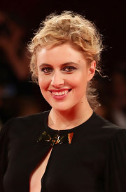 Greta Gerwig looked very feminine at the Venice Film Festival with her pinned-up ringlets.