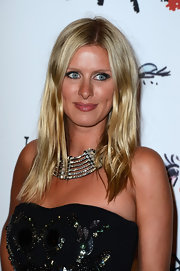 Nicky stuck to a more natural look at the Lancome party in Paris, where she kept her hair straight with a center part.