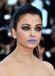 Aishwarya Rai attended the Cannes premiere of 'From the Land of the Moon' rocking bright purple lipstick!
