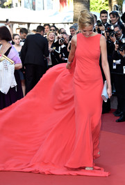 Petra Nemcova made a dramatic entrance in a coral Georges Chakra gown with a sweeping train during the Cannes premiere of 'From the Land of the Moon.'
