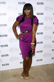 Serena Williams added glamour to her fabulous purple dress with glittery gold pumps.