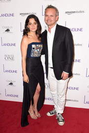 Jenny Slate polished off her look with a pair of gold triple-strap sandals by Tamara Mellon.