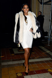 Kelly Rowland made a grand entrance at the Lanvin fashion show in a luxurious black-and-white fur coat layered over an LWD.