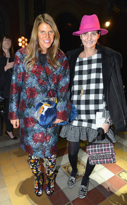 Anna dello Russo sported a dizzying mix of prints at the Lanvin fashion show with this sequined No. 21 coat and floral boots combo.