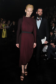 Tilda complemented her draped dress with strappy sandals.
