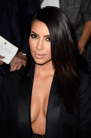 Kim Kardashian left her hair down in silken, side-parted layers when she attended the Lanvin fashion show.