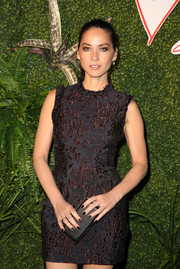 Olivia Munn went for simple styling with this black Lanvin Tejus clutch at the Evening of Fashion event.