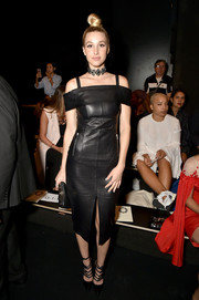 Whitney Port was rocker-glam at the Lanyu fashion show wearing this black cold-shoulder leather dress by  Rebecca Vallance.