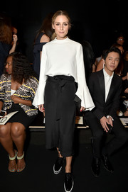 Olivia Palermo looked sweet in a loose white blouse with bell sleeves at the Lanyu fashion show.