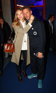 Beatrice Borromeo sported a stylish brown croc-embossed bag at the Garage Italia press conference.