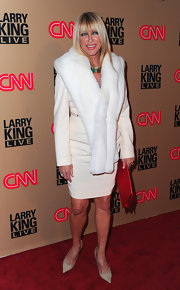 Suzanne is glamorous as ever in a white fur stole and cream colored ensemble.