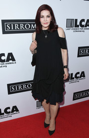 Priscilla Presley made an appearance at the Last Chance for Animals benefit wearing a cold-shoulder LBD with a ruffled skirt.