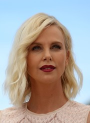 Charlize Theron attended the Cannes photocall for 'The Last Face' wearing a platinum-blonde wavy 'do.