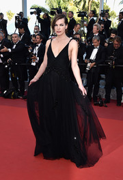 Milla Jovovich opted for a classic black Prada gown with a beaded midsection for the Cannes premiere of 'The Last Face.'