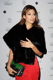 Eva holds onto her black leather clutch with a green closure flap.  An interesting choice for this old Hollywood ensemble!