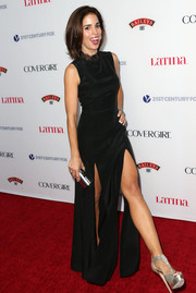 Ana Ortiz looked foxy on the Hollywood Hot List red carpet in a black evening dress with double slits.