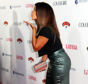 Gina Rodriguez accessorized with a cute rainbow-colored beaded clutch when she attended the Hollywood Hot List party.