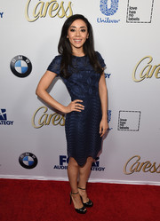 Aimee Garcia kept it modest in a navy mixed-pattern cocktail dress during the Latina Hot List party.
