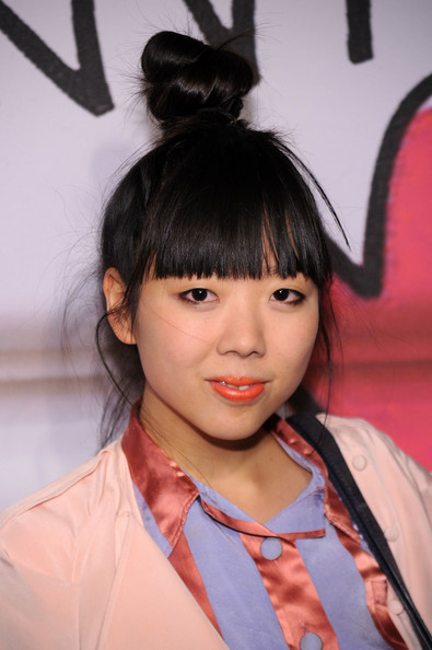 Susie showed off her signature twisted bun and blunt cut bangs while attending the Lanvin for H&M launch.