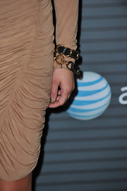 Kristin paired her tan cocktail dress with a leather bangle bracelet.