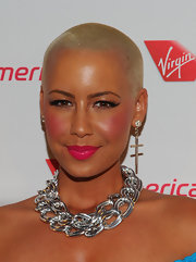 Amber Rose attended Virgin America's launch of an LA to Philadelphia flight wearing ultra-bright hot pink lipstick topped with lots of gloss.