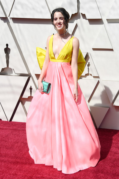 Laura Marano Satin Clutch [red carpet,fashion model,clothing,dress,carpet,gown,flooring,shoulder,pink,yellow,arrivals,laura marano,academy awards,hollywood,highland,california,annual academy awards]