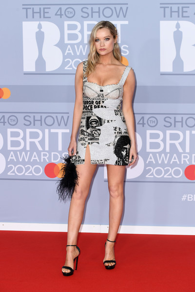 Laura Whitmore Feathered Clutch [red carpet,carpet,clothing,dress,fashion model,fashion,premiere,flooring,cocktail dress,shoulder,red carpet arrivals,laura whitmore,brit awards,england,london,the o2 arena,the brit awards 2020,laura whitmore,2020 brit awards,red carpet,fashion,celebrity,model,red carpet fashion,the brit awards,harry styles,ellie goulding]