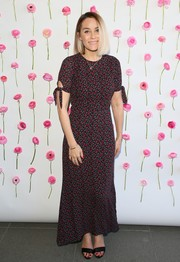 Lauren Conrad looked spring-ready in a micro-print maxi dress by Reformation while celebrating International Women's Day.