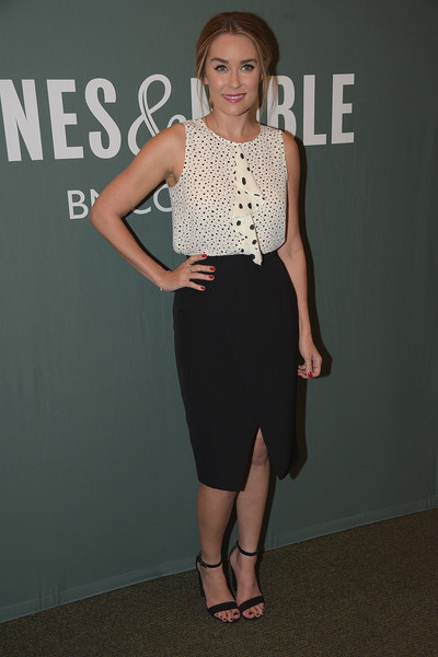 Lauren Conrad paired her top with a black front-slit pencil skirt by Paper Crown.