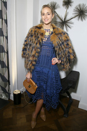 Elisabeth von Thurn und Taxis layered a fur jacket over a blue lace dress for the Wall Street Journal party.
