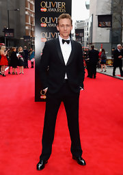 Tom Hiddleston looked dapper as ever in this black shawl-collar tux, which he sported at the Laurence Olivier Awards.