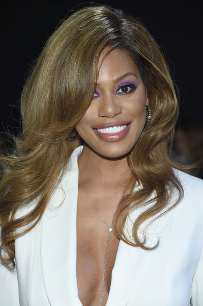 Laverne Cox Feathered Flip [shows,hair,blond,face,hairstyle,eyebrow,layered hair,brown hair,lip,chin,beauty,elie tahari,laverne cox,front row,new york city,spring studios,new york fashion week,the shows at gallery ii]