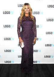 Laverne Cox went for demure elegance in a long-sleeve purple lace gown by ML Monique Lhuillier at the 'T Word' screening.