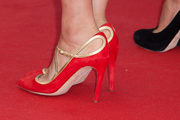 Astrid Berges-Frisbey stunned at the 'Lawless' red carpet premiere in red velvet cut-out evening pumps.