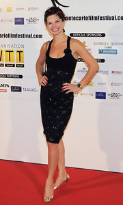Delphine Chaneac posed on the red carpet wearing gold peep-toes at the 'Le Bonheur De Pierre' photoshoot.