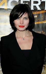 Delphine Chaneac wore a chain necklace with a silver skull pendant at the 'Le Concert' celebration party.