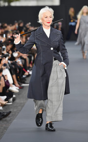 Helen Mirren walked the Le Defile L'Oreal Paris runway wearing a stylish navy coat by Ellery.