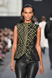 Liya Kebede was cool and edgy in a printed vest and leather pants at the Le Defile L'Oreal Paris runway show.