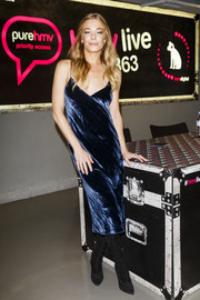 LeAnn Rimes went sultry in a low-cut blue velvet slip dress by A.O.T.C. for her album signing.