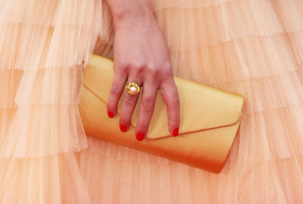 Lea Seydoux Red Nail Polish [skin,orange,yellow,hand,nail,finger,peach,wallet,fashion accessory,neck,lea seydoux,robin hood,detail view,bag,cannes,france,cannes film festival,premiere,annual cannes film festival,palais des festivals]