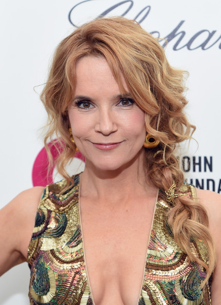 Lea Thompson Loose Braid [hair,blond,face,hairstyle,eyebrow,long hair,hair coloring,layered hair,beauty,chin,arrivals,lea thompson,elton john aids foundation oscars viewing party,part,california,los angeles,elton john aids foundation academy awards viewing party]