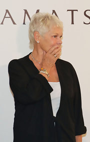 Classic Diamond studs adorn Judi Dench's ears at Praemium Imperiale Awards.