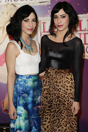 Lisa Origliasso had her hair tied up loosely at a musical premiere.