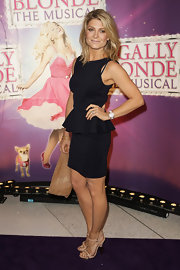 Natalie Bassingthwaighte carried a large leather clutch at a musical premiere.